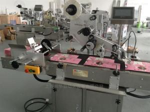面膜包装纸盒自动分页贴标机