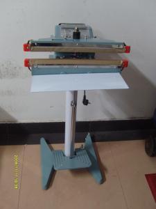 上海運馳臺式連續式墨輪印字封口機械